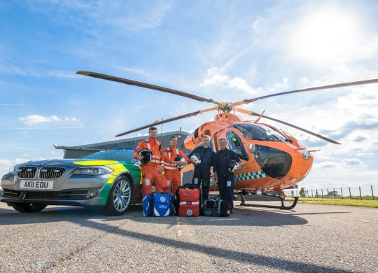 LOW-RES---Magpas-Helimedix-with-the-ELMS-BMW--helcopter-distant-1.jpg