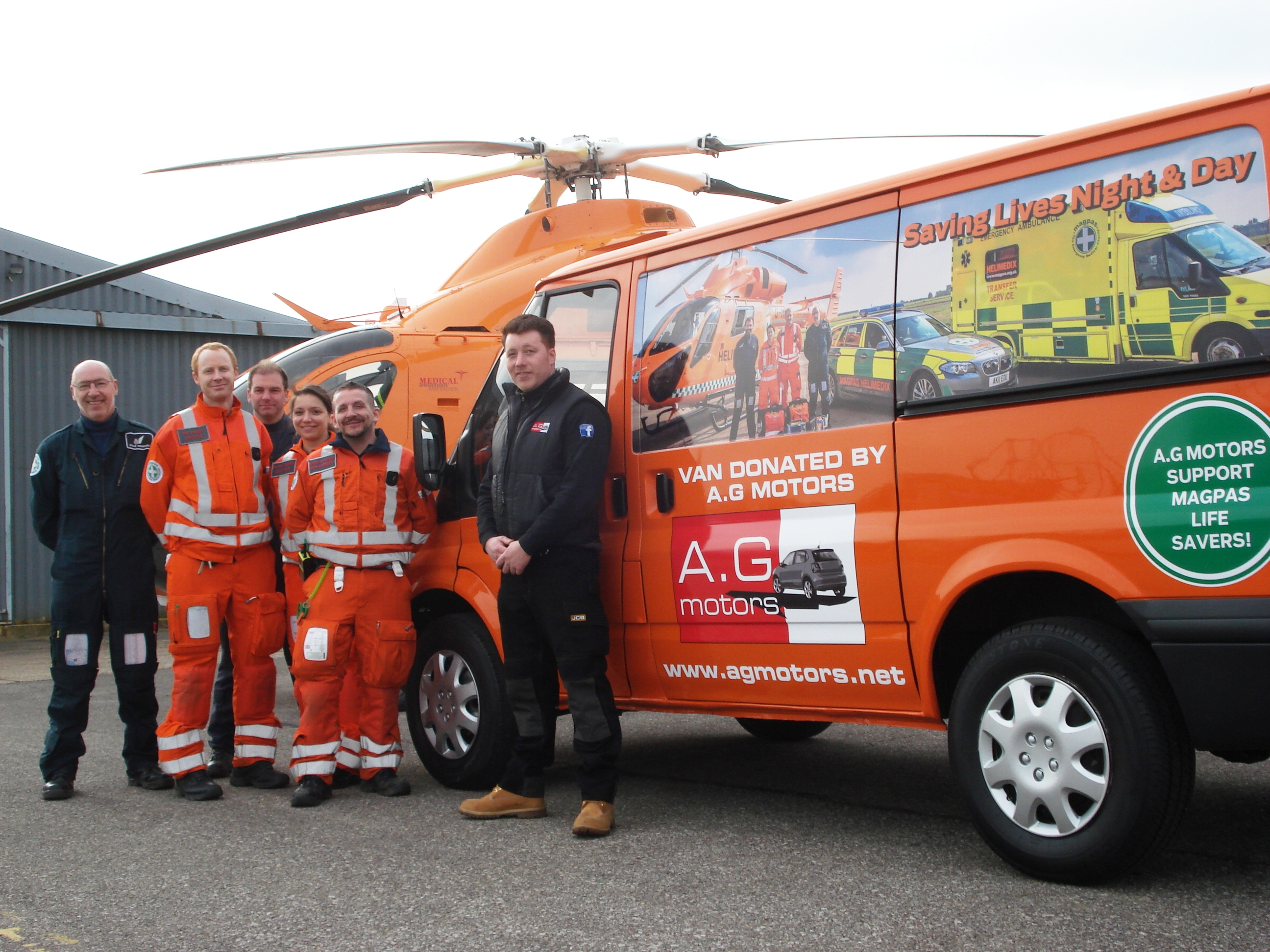 Aaron-with-the-new-van-the-helicopter-and-Helimedix-team---March-2015.jpg