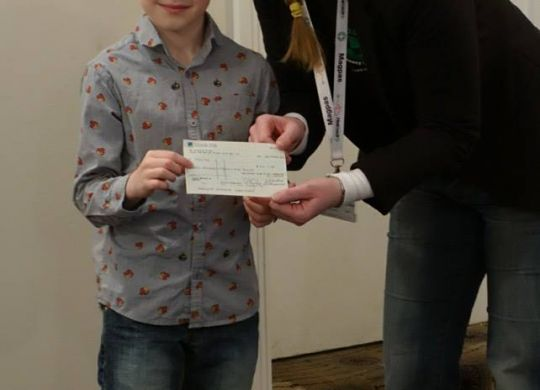Xander-and-Emma-with-cheque.jpg