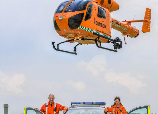 Ann-and-Mark-with-the-BMW-and-the-Magpas-Helimedix-Air-Ambulance-HIGH-RES.jpg