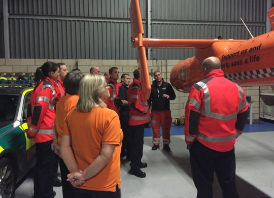 Paramedic-Chris-Hawkins-gives-tour-of-air-ambulance-to-St-Neots-Fire-Crew_LOW-RES.jpg