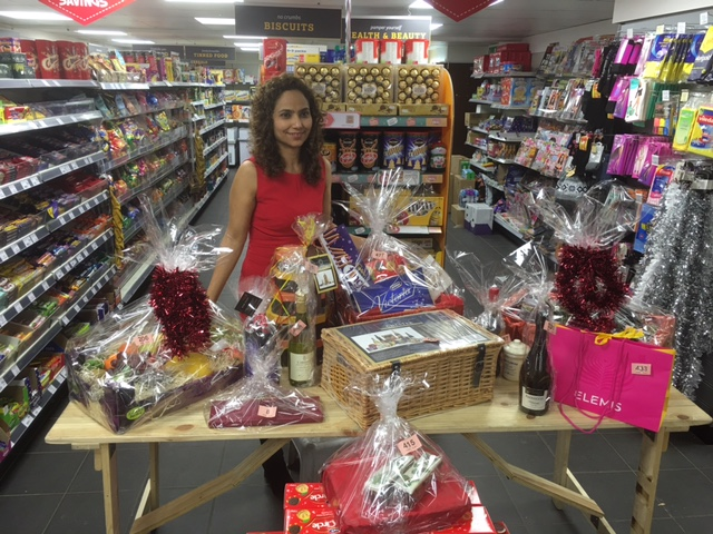 Emma-Bhachu-of-Nisa-Hardwick-Stores-with-the-raffle-prizes.jpg