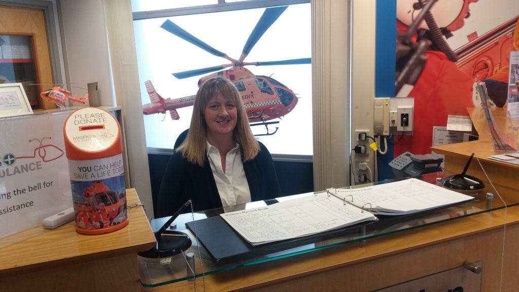 volunteer-Fay-working-at-the-Magpas-Air-Ambulance-reception-desk.jpg