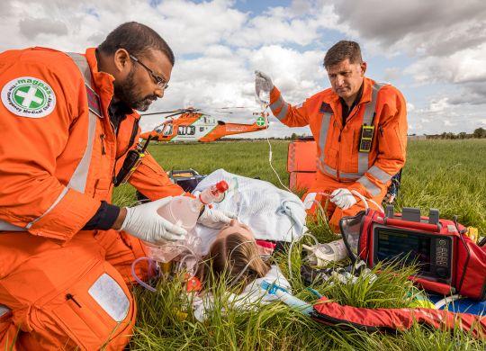Team treating patient - grass 1