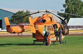 Magpas Air Ambulance landing at Peterborough Speedway on 2nd August 2015 ready to give vital lifesaving treatment to Lewis Kerr at the scene of his accident