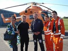 Jessie and a recovered Lewis Kerr visiting the Magpas Air Ambulance Team in October 2015; Magpas Chief Pilot Richard Eastwood, Magpas Dr Raluca Ionescu and Paramedic Dan Phillips, who all flew to Lewis on the day of the incident