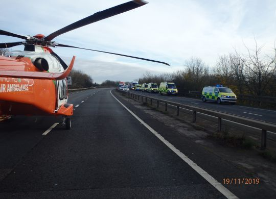 Magpas Air Ambulance on eastbound carriageway of A14 near Godmanchester, alongside EEAST Ambulance Service paramedic crews, a Hazardous Area Response Team (HART) and Cambridgeshire Police