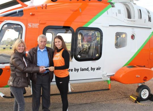 Mr Davies presenting Gaby with the cheque, alongside his neighbour Denise