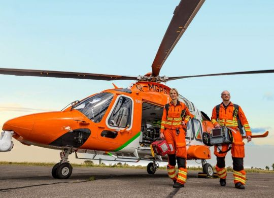 Dr Adriana and CCP Steve walking from the Magpas Air Ambulance-New-Sky_ext croppedLOWRES