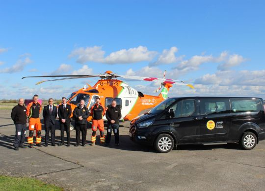 CamCab MD Rowhi Nemer with employees, the Magpas medical team & flight crew, the Magpas Air Ambulance and CamCab taxi (high res version upon request)