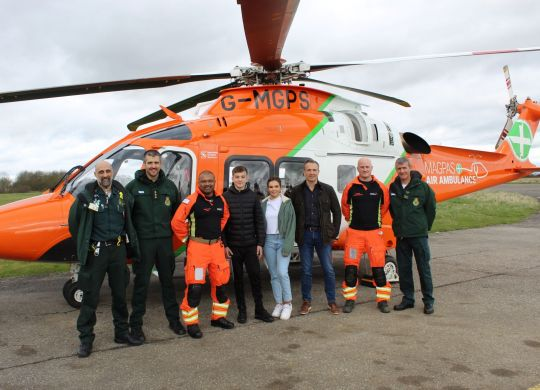One year on: Alice and her family with the EEAST Ambulance Service paramedics and Magpas Air Ambulance doctor and  critical care paramedic who helped save her life